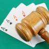 An image of a gavel on top of cards